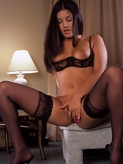 Luscious raven haired beauty shows off her body for us all to see.
